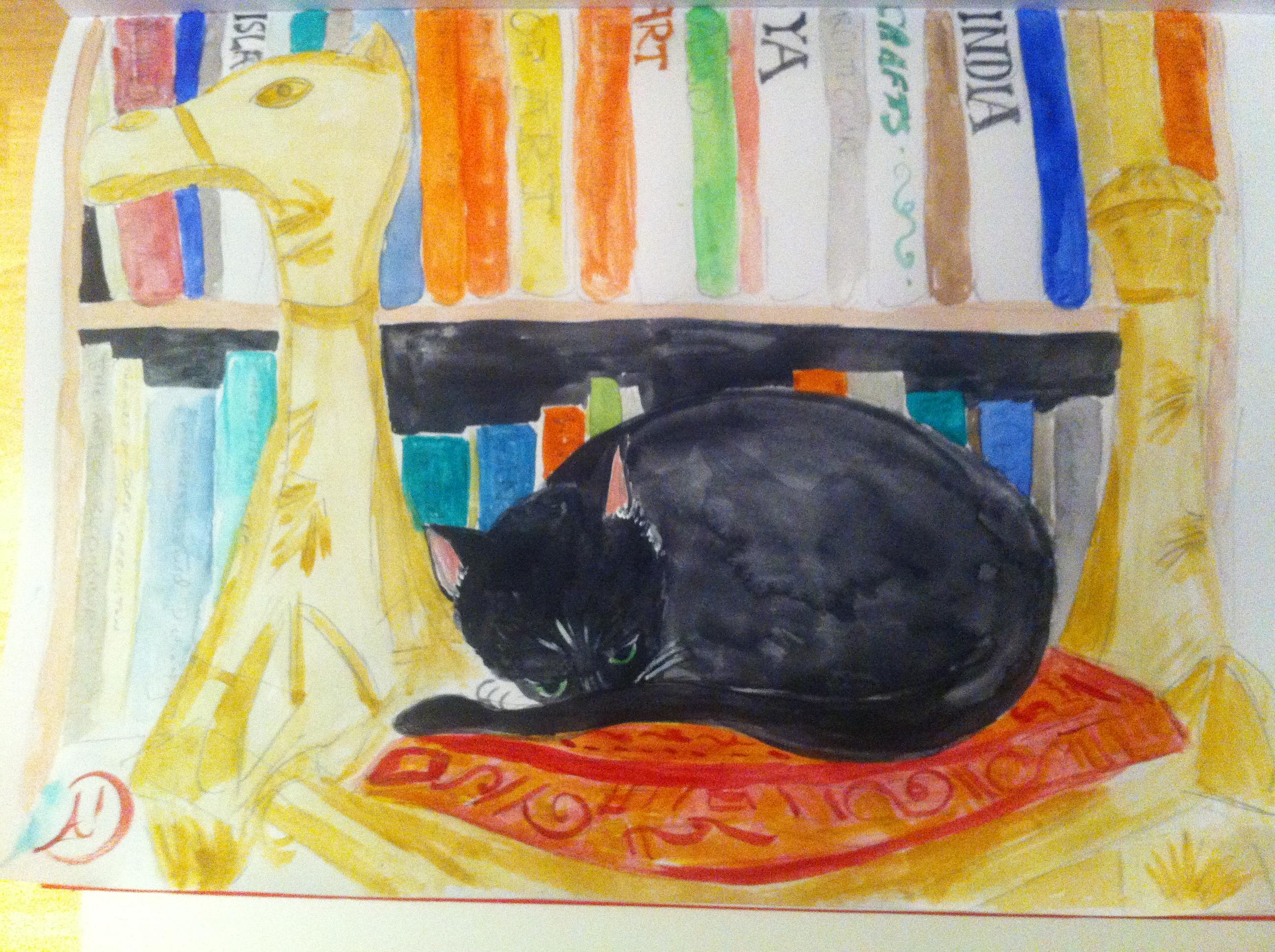 My old cat Brzeska having a nap on the Syrian camel foot stool.